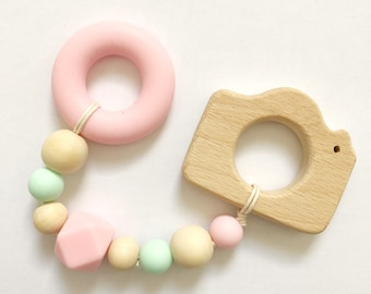 Rattle Teether wood and silicone camera pink and mint