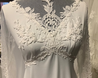 Seventies jersey knit bridal gown with cape