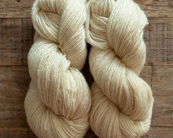 """Undyed cream BLF x Gotland sport weight yarn, 415 yards per 170 grams, 2 ply, """"Miss Vicki"""", Canadian grown and spun, oversized skeins"""