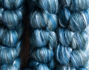 Organically farmed Falklands Merino mulberry silk blend dyed top, shades of blue, grey, and white, Poseidon, 100 gram bumps