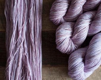 "Hand dyed merino nylon blend fingering weight sock yarn, 425 yards, 100 grams, 4 ply, superwash, ""Plum Tart"", soft mauve purple"