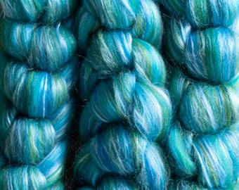 Organically farmed Falklands Merino mulberry silk blend dyed top, shades of turquoise, teal, and green, Siren, 100 gram bumps
