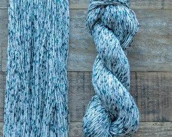 Black and teal speckled cotton yarn, sport weight, 2 ply, 290 metres per 100 grams, price per skein