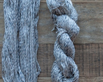 Silver grey  with blue, slate, and grey thread, 100% Cotton yarn, sport weight, 290 metres per 100 grams, price per skein