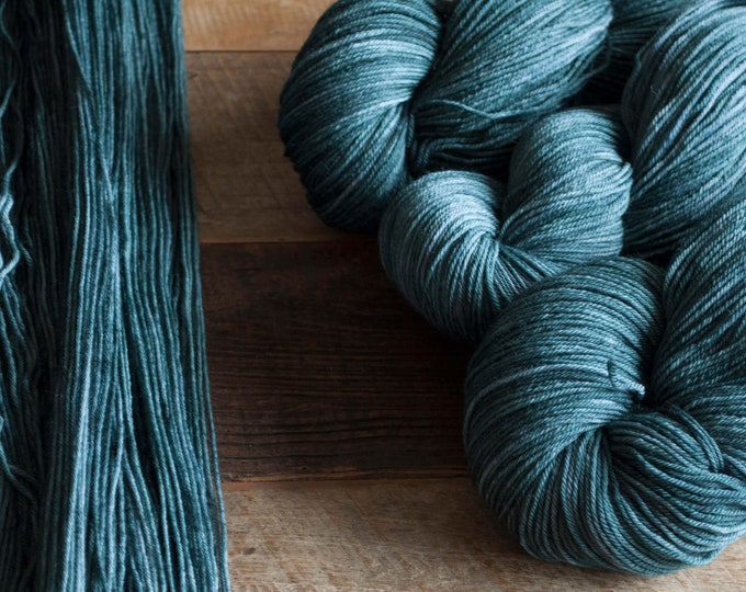 "Featured listing image: Hand dyed merino nylon blend fingering weight sock yarn, 425 yards, 100 grams, 4 ply, superwash, ""Ink"", dark blue green"