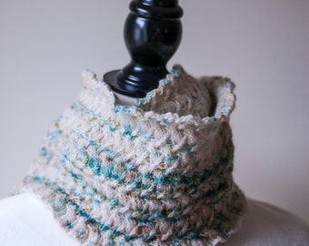 Handknit white and green cable pattern cowl
