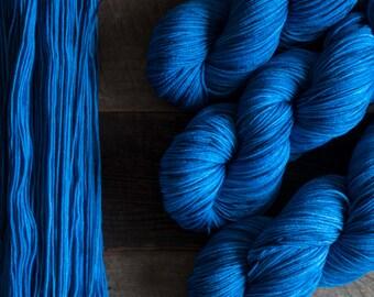 "Hand dyed merino nylon blend fingering weight sock yarn, 425 yards, 100 grams, 4 ply, superwash, ""Bluestone"", rich bright blue"