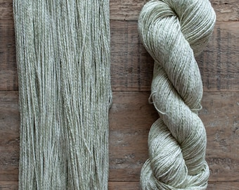 Pale green and white variegated cotton yarn, sport weight, 2 ply, 290 metres per 100 grams