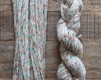 Pink, green, orange, and yellow speckled cotton yarn, sport weight, 2 ply, 290 metres per 100 grams, price per skein
