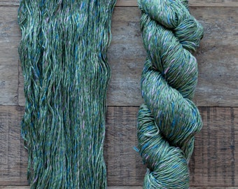 Green with blue, green, and pink rainbow thread, 100% Cotton yarn, sport weight, 290 metres per 100 grams, price per skein