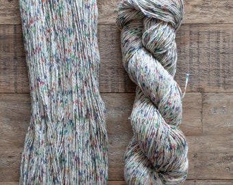 Red, blue, green, yellow speckled cotton yarn, sport weight, 2 ply, 290 metres per 100 grams, price per skein