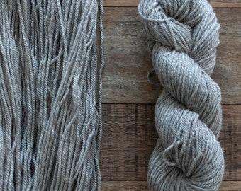 Five skeins of undyed natural grey BFL Masham blend Aran weight yarn, 175 yards, 100 grams, 3 ply, non-superwash