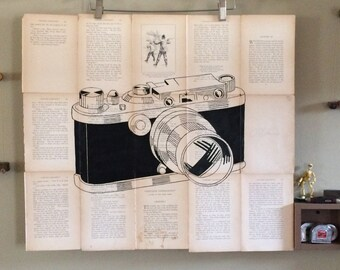 Hand painted one of a kind Vintage Camera on old book pages