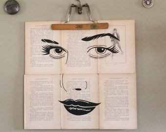 Hand painted one of a kind womans face on old book pages