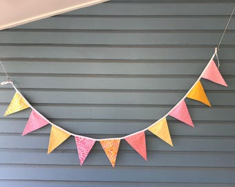 Pink, and yellow bunting