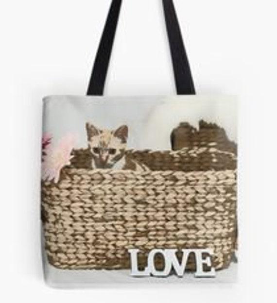 Chat dans un panier sac fourre-tout