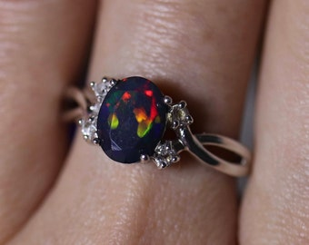 966279442 Natural black fire opal engagement ring made w white topaz accent stones on  both sides and a fabulous rare 8x6mm black opal