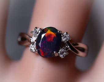 Natural black fire opal engagement ring made w white topaz accent stones on both sides and a fabulous rare 8x6mm black opal