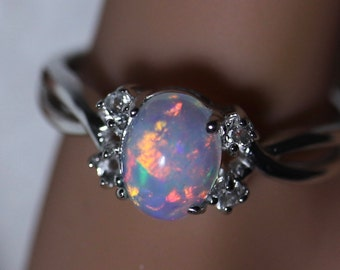 Wonderful glimmering fire opal, unique color palette, dainty opal ring, accented opal ring, opal engagement ring, delicate silver opal ring