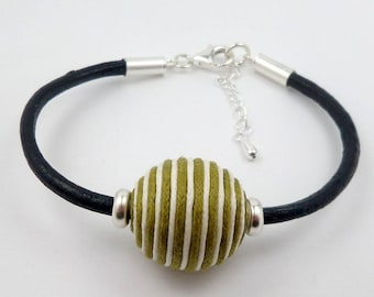 Silver bracelet blue leather and solid dark beige olive green striped bead