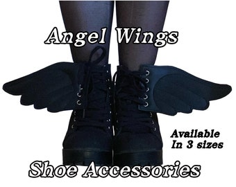 Angel wing shoe accessories, available in 3 sizes.