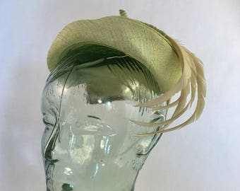 Key Lime green hat with cream curled feathers