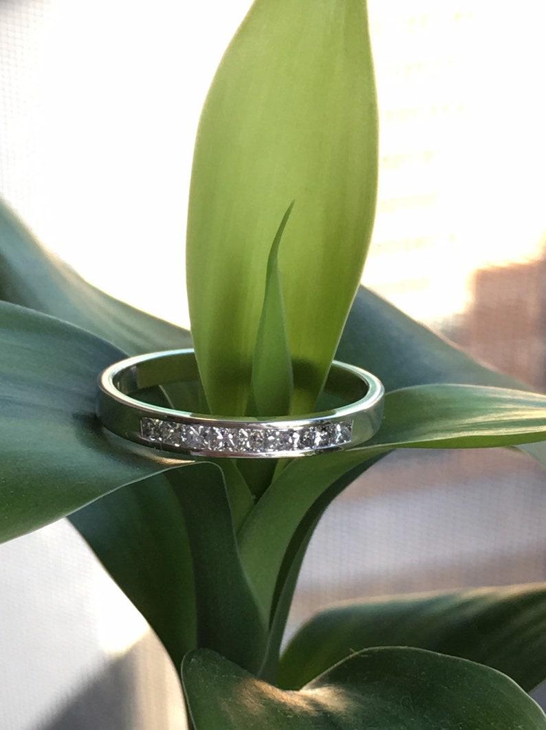 Channel set princess cut Diamond Ring in 14k white Gold 0.20Ct.