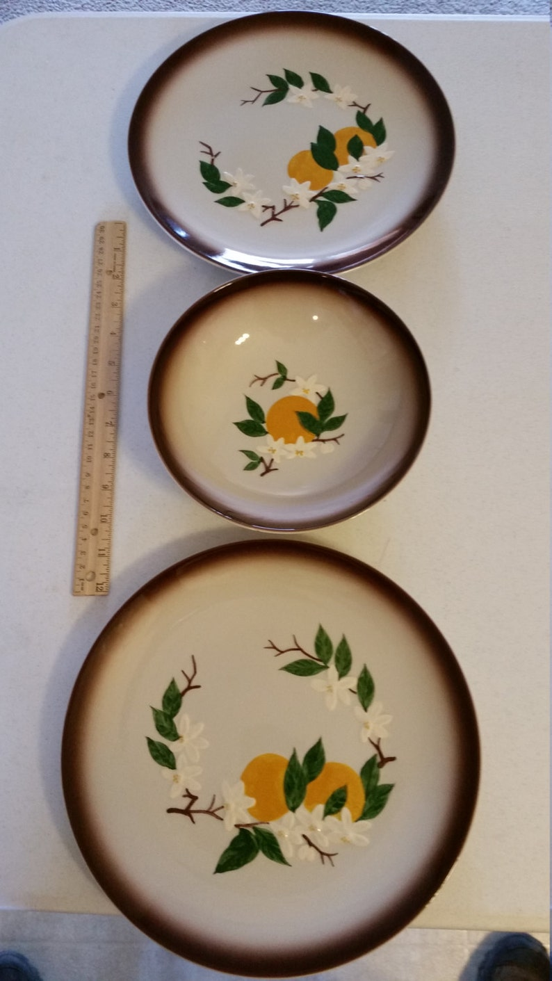 vintage orchard ware plates and bowl california retro 1950 era dinnerware oranges and blossoms ceramic hand decorated fruit decor kitchen