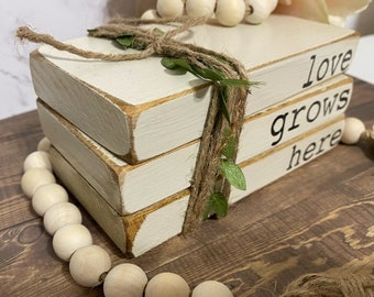 farmhouse rustic book display book stack wood books love grows here