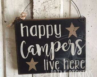 Happy campers live here // camping sign