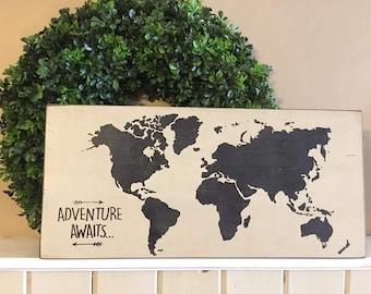 Ready to ship // Adventure awaits world map // map on wood // world // travel