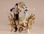 A pair antique German porcelain figurines Marked Dresden style saxe