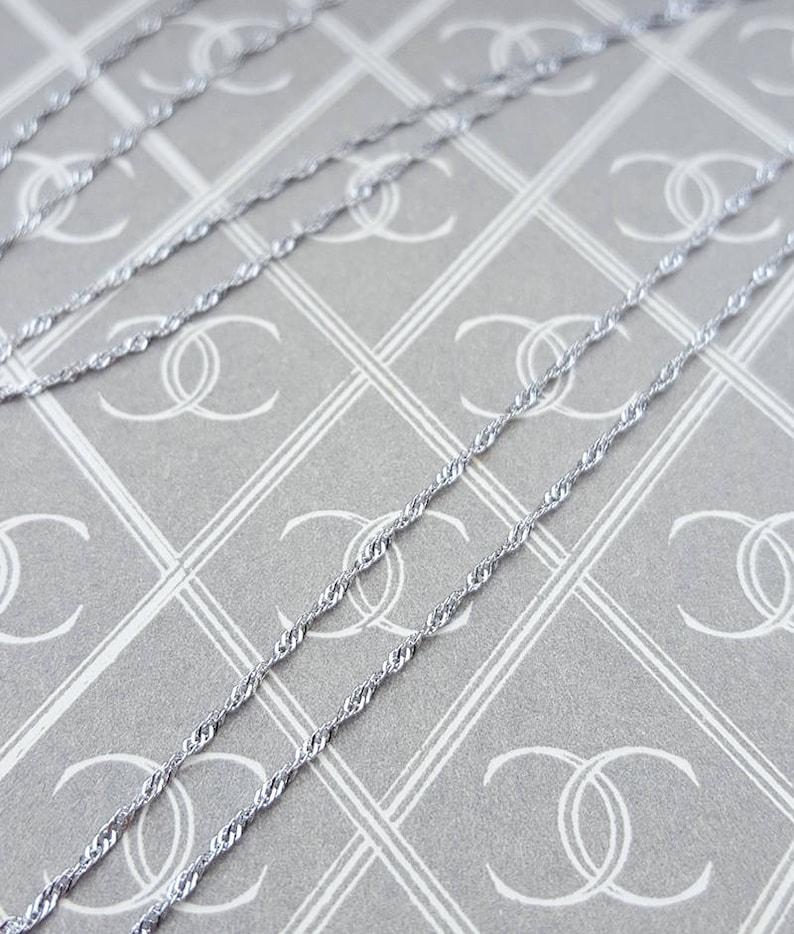 d6a62298ddfec 9ct White Gold 0.9mm Diamond Cut Twist Curb Chain Necklace 16