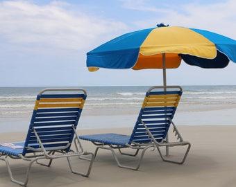Beach Chairs and Umbrella overlooking the ocean on Daytona Beach, Florida