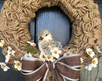 Twine loop cherry blossom burlap wreath with bird