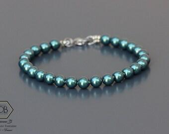 Bracelet Femme en perles Swarovski vert tahitien. Apprêts inox