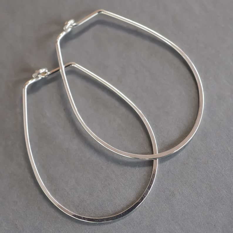 Minimalist Hoops. Polished Sterling Silver Oval Earrings by image 0