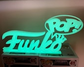 Custom Funko Pop Display Logo Glows Green In The Dark.