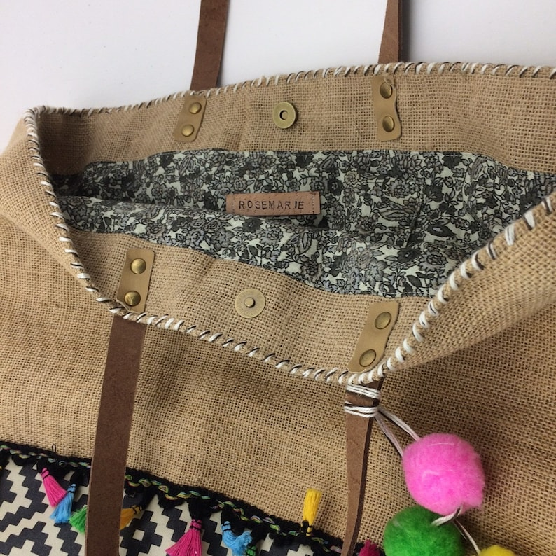 Distressed leather handles. tassels with bright colors Tote pattern Barcelona in Burlap with ethnic patterns