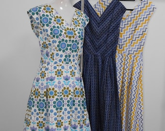 Inspired by a  Circa 1957 pattern, 100% cotton sundress with box pleat skirt has V neckline and side zip. Also available in womens sizing.