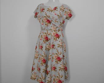 Inspired by a 1953 dress pattern. This dress is made of 100% cotton broadcloth. And has a warp over front. Size 18