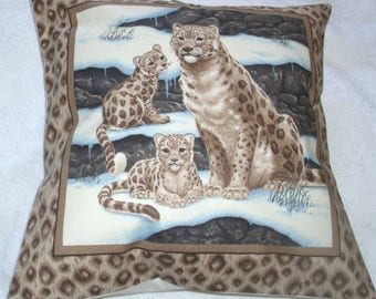 Beautiful Snow Leopard sitting with her two cubs cushion