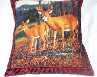 Stag and deer standing in a clearing in a forest in Autumn cushion