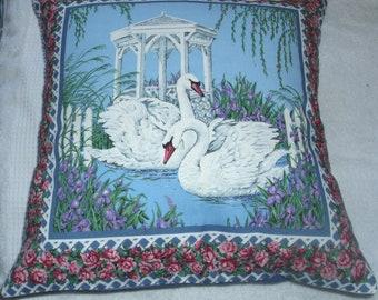 Swans on a lake with irises cushion