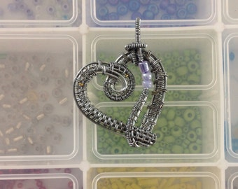 Wire wrapped heart pendant.