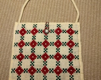 Vintage handmade cross stitch tote in cream with a red and green pattern decorative button