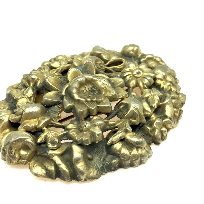 Antique Floral Pressed Brass Brooch