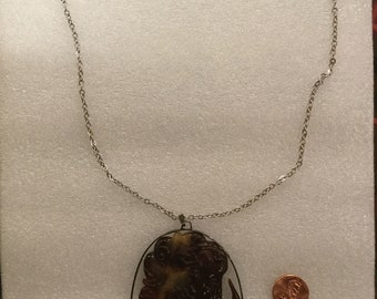 Late 19th Century Victorian Tortoise Cameo Pendant set in Sterling Silver with Modern Silver Chain