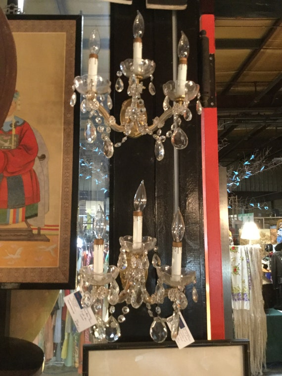 A Pair Of Ca. 1940s Maria Theresa 3 light Crystal Wall Sconces