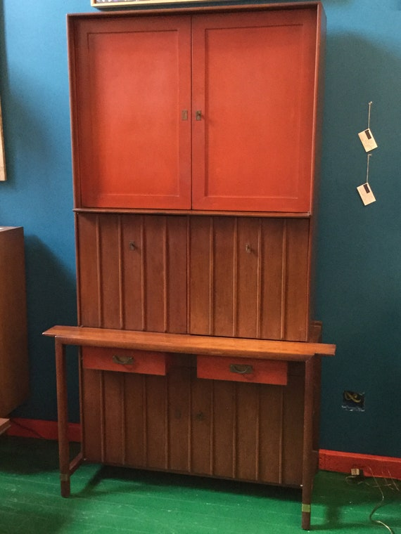 SOLD - Mid Century Secretary or Bar Unit for Office Library Living room in Rosewood with Orange Front cabinets And Drawers